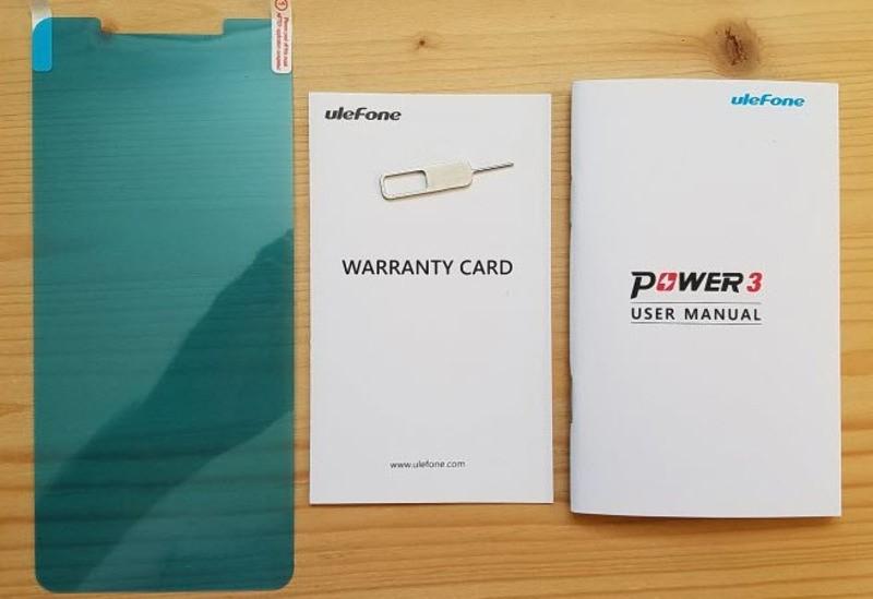 Рис.3 Скрепка для отпирания лотка сим-карты, документация и защитная пленка.